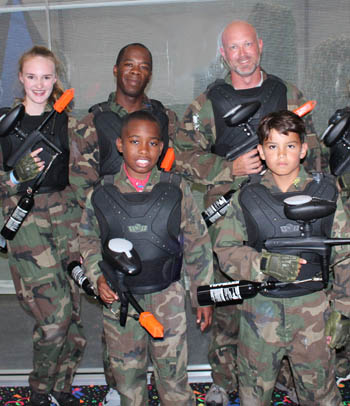 Families can play paintball together.
