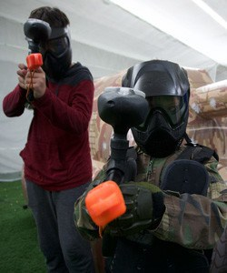 Wear long sleeves and long pants to minimize the sting of paintballs.